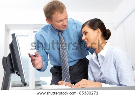 Manager giving opinion to his secretary