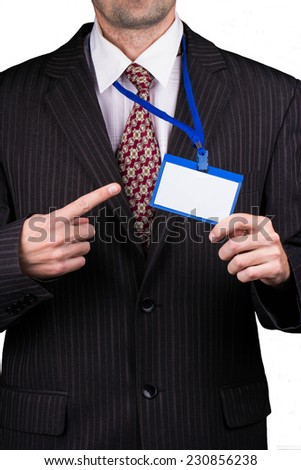 Manager holding a badge and points his finger at him - stock photo