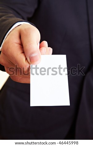 Manager holding an empty white business card