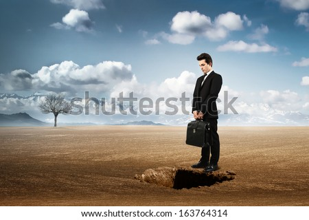 manager in front of the hole