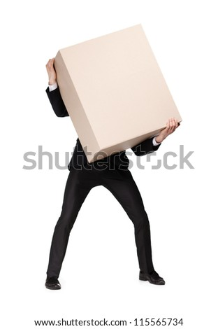 Manager in suit bears a huge parcel, isolated on white - stock photo