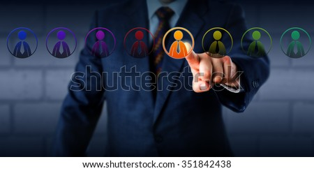 Manager is selecting one virtual worker in a lineup of eight differently colored male employee icons. Concept for multiculturalism, equal opportunity employment and a business case for diversity. - stock photo