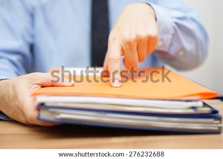 manager is showing priority work to do to his employee - stock photo