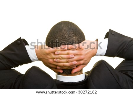 Manager leaning back with his hands crossed - stock photo