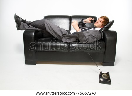 manager on sofa with retro phone