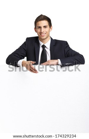 Manager pointing hand gestures at copyspace, isolated. Concept of success and advertisement - stock photo