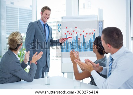 Manager presenting whiteboard to his colleagues against two transfused patients lying on a medical bed - stock photo