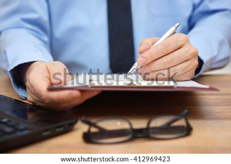 Manager reading report, concept of accounting, report and leadership