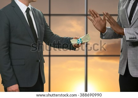 Manager rejects money in office. Darkskinned businessman refusing huge money. My word doesn't sell. Honesty and courage. - stock photo