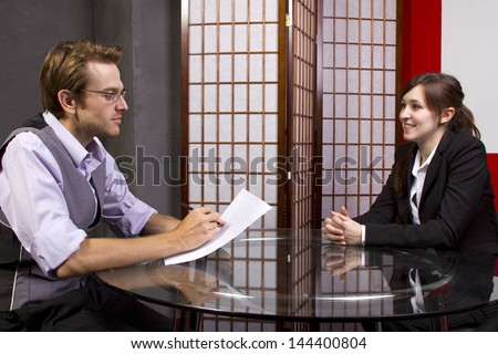 Manager reviewing workers job performance - stock photo