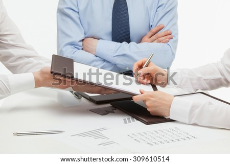 Manager signing a contract, white background - stock photo