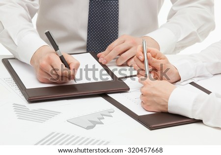 Manager signing a contract, white background