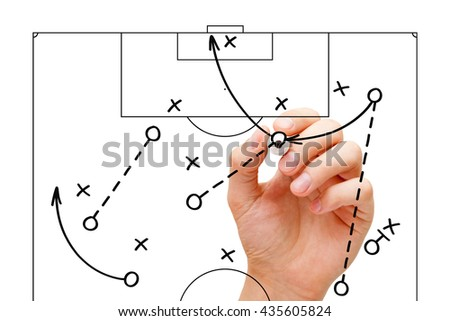 Manager sketching a football game strategy with marker on transparent wipe board. Soccer coach explaining play tactics. - stock photo