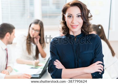 Manager with her team working in the office - stock photo