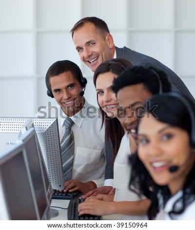 Manager with his multi-ethnic business team working in a call center