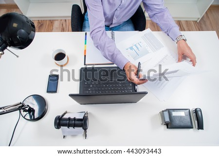 manager works in office behind the desk / office work