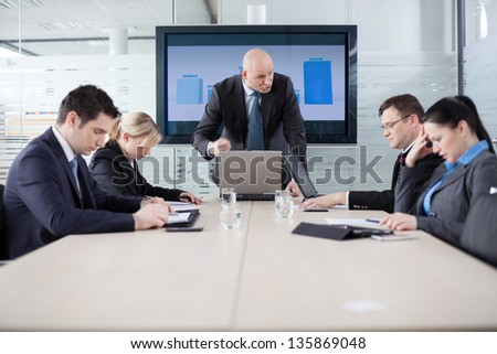 Manager yelling at his employees at the meeting. Company is in recession. - stock photo