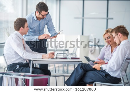 Managers at meeting in modern office - stock photo