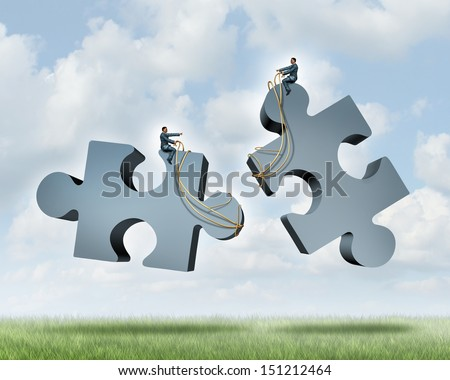 Managing a partnership as an agreement or contract to work together for financial success as two business people steering with a harness giant jigsaw puzzle pieces as a concept of team cooperation. - stock photo