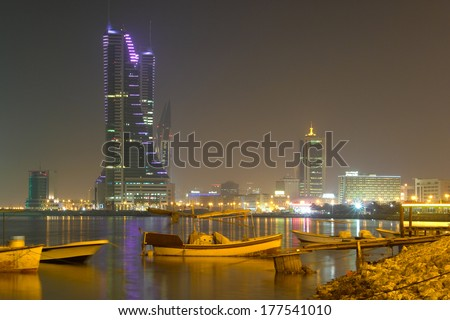 MANAMA, BAHRAIN - AUGUST 25, 2008: Manama city view at night including Bahrain Financial Harbor and Bahrain World Trade Center - stock photo