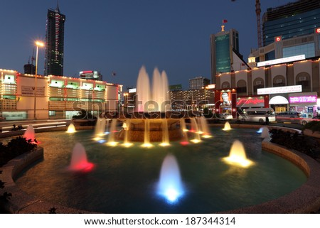MANAMA, BAHRAIN - DEC 22: Fountain illuminated at night in the city of Manama. December 22nd 2013 in Manama, Kingdom of Bahrain, Muddle East