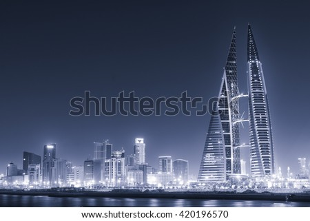 MANAMA, BAHRAIN - May 14: Bahrain World Trade Center Skyscraper and other tall high rise buildings  in Manama City. May 14-2016 in Manama, Kingdom of Bahrain - Cyanotype converted picture. - stock photo