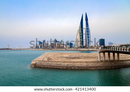 MANAMA, BAHRAIN- MAY 14: Manama Seafront with Bahrain World Trade Center and other high rise buildings in Manama City in a hazy evening on May 14, 2016, Manama, Bahrain - stock photo