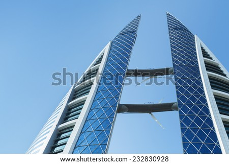Manama, Bahrain - November 21, 2014: Bahrain World Trade Center complex, first skyscraper in the world with integrated wind turbines - stock photo