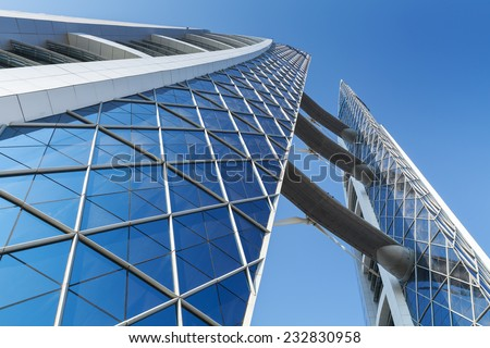 Manama, Bahrain - November 21, 2014: Bahrain World Trade Center. This is a 240-meter-high, 50-floor, twin tower complex, built in 2008, first skyscraper in the world with integrated wind turbines - stock photo