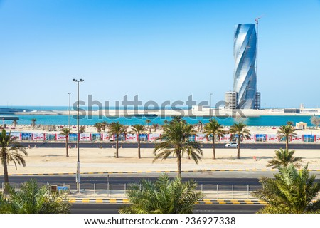 Manama, Bahrain - November 21, 2014: City scape with United Tower under construction in Manama city, Capital of Bahrain Kingdom - stock photo