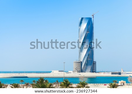 Manama, Bahrain - November 21, 2014: Modern skyscraper building United Tower under construction in Manama city, Capital of Bahrain Kingdom - stock photo