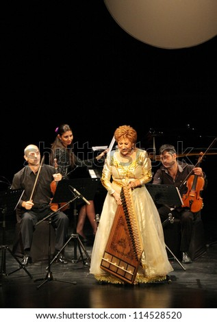 MANAMA, BAHRAIN - OCTOBER 01: Hasmik Leyloyan, the Queen of Qanun with her orchestra performs on October 01, 2012 in Bahrain on the occasion of the 21st Bahrain International music festival - stock photo