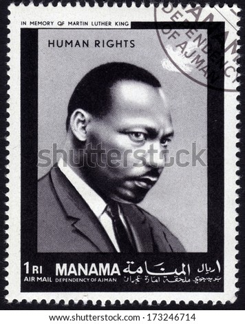 MANAMA - CA. 1969: Postage stamp from Manama showing the image of civil and human rights activist Martin Luther King - stock photo