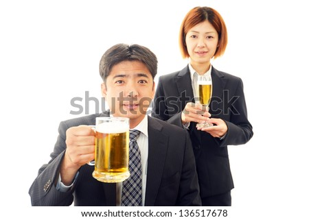 Manand woman drinking beer - stock photo