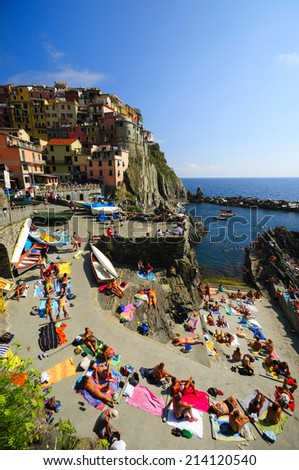 Manarola, Italy-09.August 2014., Tourists are sunbathing at UNESCO World Heritage Site, Cinque Terre, Italian Riviera, Liguria