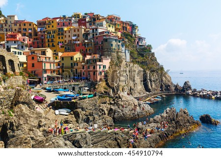 Manarola, Italy - July 02, 2016: picturesque town Manarola with unidentified people. Manarola is one of the famous five UNESCO protected picturesque towns in the Cinque Terre.