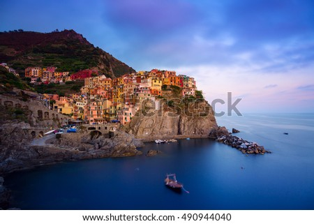 Manarola village at twilight. Manarola is a small town in the province of La Spezia, Liguria, northern Italy