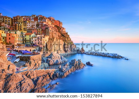 Manarola village on cliff rocks and sea at sunset., Seascape in Five lands, Cinque Terre National Park, Liguria Italy Europe. Long Exposure Photography. - stock photo