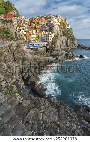 Manarola village on cliff rocks and sea, Seascape in Five lands, Cinque Terre National Park, Liguria, Italy, Europe.  - stock photo