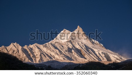 Manaslu mountain as viewed in its full glory at sunrise from a small Tibetan village of Samagaon, located on the trail of the famous Around Manaslu trek, Manaslu Himal, Nepalese Himalyas, Nepal