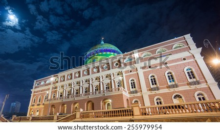 MANAUS - AUG 9: Amazonas Theatre side view by night on August 9, 2014 in Manaus, Brazil. The opera house was built when fortunes were made in the rubber boom. - stock photo