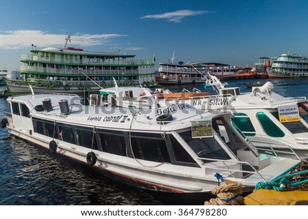 MANAUS, BRAZIL - JULY 27, 2015: River boats anchored at the passenger pier in Manaus, Brazil