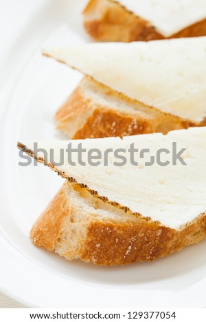 Manchego cheese tapas. Typical spanish pub food. - stock photo