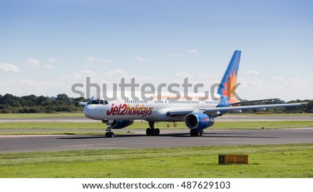 MANCHESTER AIRPORT -  AUGUST 29th 2016: Jet2Holidays 757-236 aircraft taxiing back to the terminal at Manchester Airport, UK August 29th, 2016