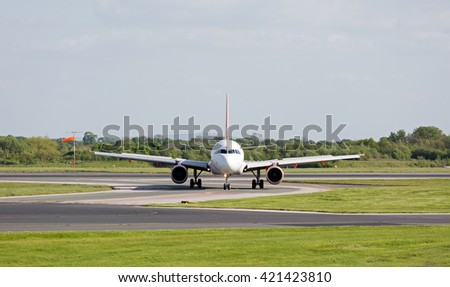 MANCHESTER AIRPORT - MAY 14th 2016: Easyjet Airbus A320 taxiing on the runway at Manchester Airport, UK May 14, 2016 - stock photo