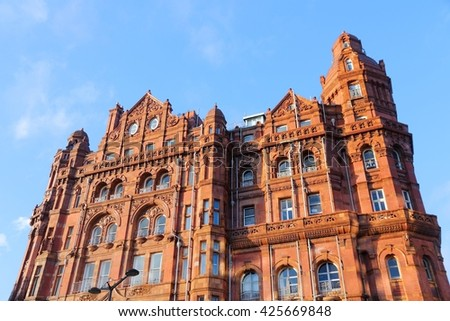 Manchester - city in North West England (UK). Famous hotel built in eclectic Edwardian baroque architecture style. Listed building. - stock photo