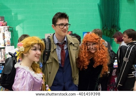 MANCHESTER, ENGLAND - APRIL 2, 2016: Disnet Princess and Dr Who Cosplayers pose at the Manchester Anime and Gaming Convention - stock photo