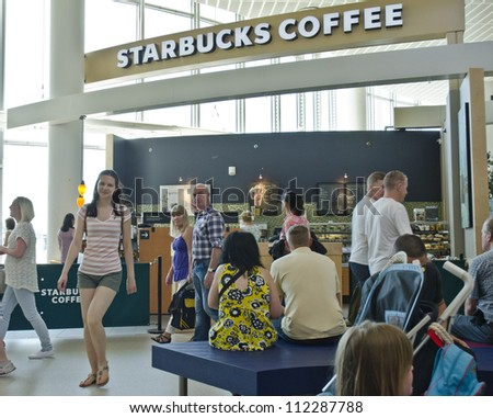 MANCHESTER, ENGLAND - MAY 26: a Starbucks Coffee outlet on May 26, 2012 in Manchester, England. On September 6, Starbucks announced a $78m investment to enter the Indian market. - stock photo