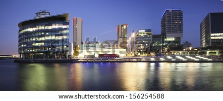 MANCHESTER, ENGLAND - SEPT 29: Media City on September 29, 2013 in Salford Quays, England. The location for the new BBC terrestrial broadcasting studios for TV and radio in the UK. - stock photo