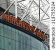 MANCHESTER, ENGLAND - SEPT 3: Old Trafford stadium on September 3rd, 2012 in Manchester, England. Old Trafford is home to Manchester United football club one of the most successful clubs in England - stock photo